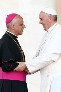 VATICAN CITY, VATICAN - MAY 18: Pope Francis greets Archbishop Rino Fisichella, president of the Pontifical Council for Promoting New Evangelisation, during the celebration of Pentecost Vigil with lay Ecclesial movements in St. Peter's Square on May 18, 2013 in Vatican City, Vatican. This weekend tens of thousands of people descend on the Vatican to celebrate the Pentecost Vigil together with Pope Francis. Echoing similar celebrations that took place with his predecessors Blessed John Paul II and Benedict XVI, the Holy Father has called the New Movements and Ecclesial Communities to invoke the Holy Spirit upon them and their continued mission in the life of the Church. (Photo by Franco Origlia/Getty Images)