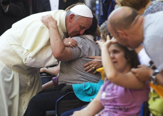 Pope Francis blesses sick and disabled people at the end of a pro-life Mass in St. Peter's Square, at the Vatican, Sunday, June 16, 2013. The pontiff on Sunday blessed thousands of Harley Davidsons and their riders as the American motorcycle manufacturer celebrated its 110th anniversary with a loud parade and plenty of leather. In St. Peter's Square, bikers in their trademark leather Harley vests sat alongside nuns and tens of thousands of faithful Catholics taking part in an unrelated, two-day pro-life rally, the centerpiece of which was Francis' Mass. (AP Photo/Andrew Medichini)